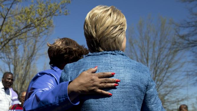 Democratic presidential candidate Hillary Clinton turns to pose for a photograph with a supporter as she greets people at a polling place at Southeast Raleigh Magnet High School in Raleigh, N.C., Tuesday, March 15, 2016. Clinton faces Democratic rival Bernie Sanders in primary contests in five states on Tuesday: North Carolina, Florida, Ohio, Missouri and Illinois. (AP Photo/Carolyn Kaster)