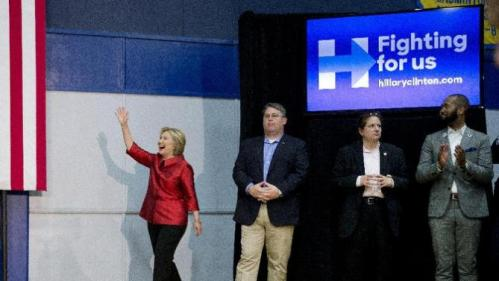 Democratic presidential candidate Hillary Clinton waves as she arrives to speak at a campaign event at Carl Hayden Community High School in Phoenix, Monday, March 21, 2016. (AP Photo/Carolyn Kaster)