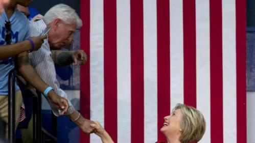Democratic presidential candidate Hillary Clinton reaches to shake hands as she arrives to speak during a campaign event at Carl Hayden Community High School in Phoenix, Monday, March 21, 2016. (AP Photo/Carolyn Kaster)