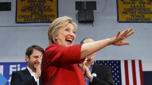Democratic U.S. presidential candidate Hillary Clinton waves at a campaign rally at Carl Hayden Community High School in Phoenix, Arizona March 21, 2016. REUTERS/Mario Anzuoni