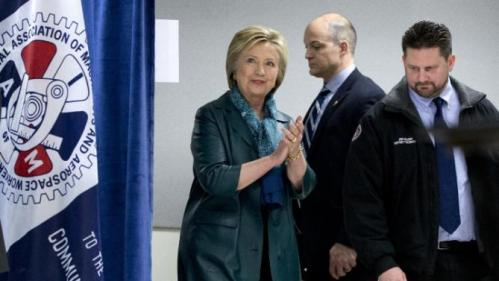 Democratic presidential candidate Hillary Clinton arrives with Union District President Jon Holden, right, for a campaign event at the IAM District 751 Everett Union Hall in Everett, Wash., Tuesday, March 22, 2016. (AP Photo/Carolyn Kaster)
