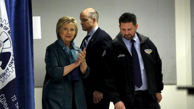 Democratic U.S. presidential candidate Hillary Clinton and Machinists District 751 President Jon Holden (R) arrive for a labor organizing event at Everett Union Hall in Everett, Washington March 22, 2016. REUTERS/Mario Anzuoni