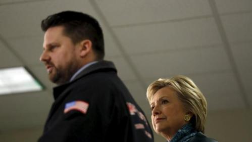 Democratic U.S. presidential candidate Hillary Clinton listens to Machinists District 751 President Jon Holden during a labor organizing event at Everett Union Hall in Everett, Washington March 22, 2016. REUTERS/Mario Anzuoni