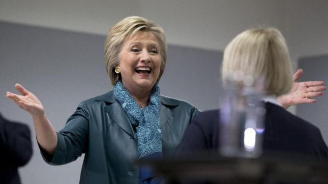 Democratic presidential candidate Hillary Clinton is greeted by Sen. Patty Murray, D-Wash., as she arrives to speak during a campaign event at the IAM District 751 Everett Union Hall in Everett, Wash., Tuesday, March 22, 2016. (AP Photo/Carolyn Kaster)