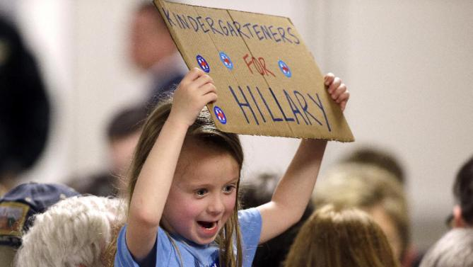 A young girl holds up a sign following a campaign event for Democratic presidential candidate Hillary Clinton at the Boeing Machinists' union hall Tuesday, March 22, 2016, in Everett, Wash. (AP Photo/Elaine Thompson)