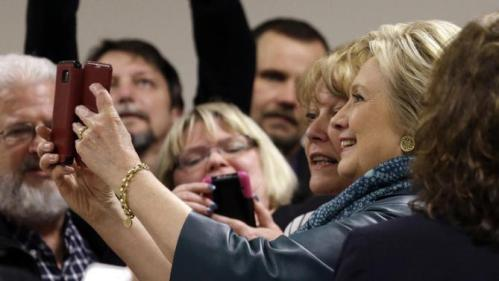 Democratic presidential candidate Hillary Clinton takes a selfie with a supporter and her camera following a campaign event at the Boeing Machinists' union hall Tuesday, March 22, 2016, in Everett, Wash. (AP Photo/Elaine Thompson)