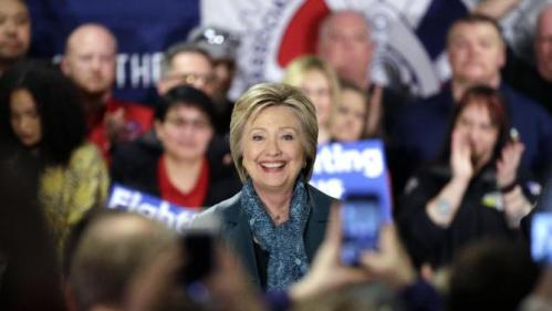 Democratic presidential candidate Hillary Clinton smiles as she takes to the stage during a campaign event at the Boeing Machinists' union hall Tuesday, March 22, 2016, in Everett, Wash. (AP Photo/Elaine Thompson)