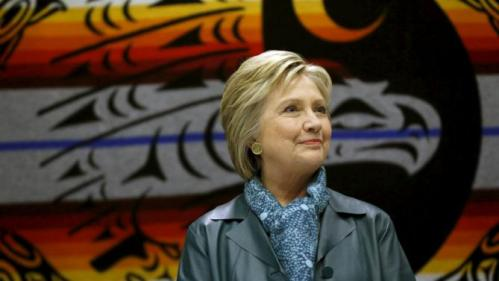 Democratic U.S. presidential candidate Hillary Clinton watches a performance during a roundtable discussion with Washington tribal leaders at Chief Leschi school in Puyallup, Washington March 22, 2016. REUTERS/Mario Anzuoni