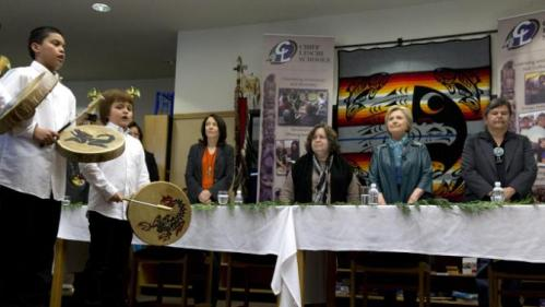 Students perform as Democratic presidential candidate Hillary Clinton arrives for a roundtable with Washington Tribal Leaders at Chief Leschi School in Puyallup, Wash., Tuesday, March 22, 2016. With Clinton at the table from left are Sen. Maria Cantwell, D- Wash., Puyallup tribal members Rollen Hargrove, and Bill Sterud. (AP Photo/Carolyn Kaster)