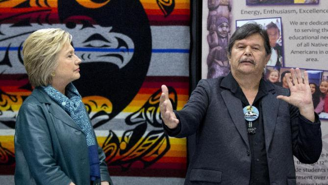 Democratic presidential candidate Hillary Clinton looks to Puyallup tribal member Bill Sterud, as he speaks during a roundtable with Washington Tribal Leaders at Chief Leschi School in Puyallup, Wash., Tuesday, March 22, 2016. (AP Photo/Carolyn Kaster)