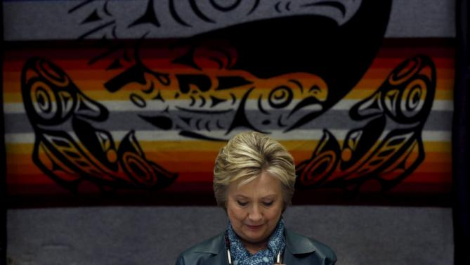 Democratic U.S. presidential candidate Hillary Clinton wears an Indian necklace during a roundtable discussion with Washington tribal leaders at Chief Leschi school in Puyallup, Washington March 22, 2016. REUTERS/Mario Anzuoni