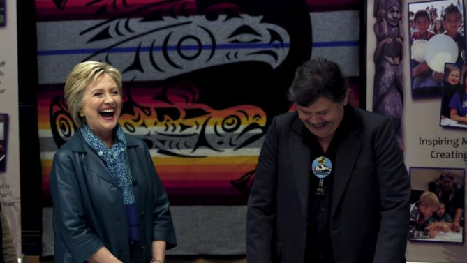 Democratic U.S. presidential candidate Hillary Clinton listens to Puyallup Tribe Chairman Bill Sterud during a roundtable discussion with Washington tribal leaders at Chief Leschi school in Puyallup, Washington March 22, 2016. REUTERS/Mario Anzuoni