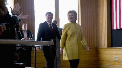 Democratic presidential candidate Hillary Clinton arrives with former United States Ambassador to Russia Michael McFaul to speak about counterterrorism, Wednesday, March 23, 2016, at the Bechtel Conference Center at Stanford University in Stanford, Calif. (AP Photo/Carolyn Kaster)