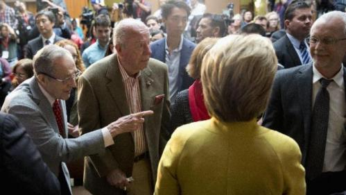 Former Defense Secretary William Perry, left , introduces Democratic presidential candidate Hillary Clinton to his son David Perry, right, as former Secretary of State George Shultz stands second from left, after Clinton spoke about counterterrorism, Wednesday, March 23, 2016, at the Bechtel Conference Center at Stanford University in Stanford, Calif. (AP Photo/Carolyn Kaster)