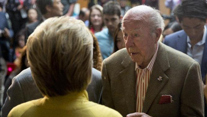 Democratic presidential candidate Hillary Clinton speak with President Ronald Reagan's former Secretary of State George Shultz after speaking about counterterrorism, Wednesday, March 23, 2016, at the Bechtel Conference Center at Stanford University in Stanford, Calif.  (AP Photo/Carolyn Kaster)
