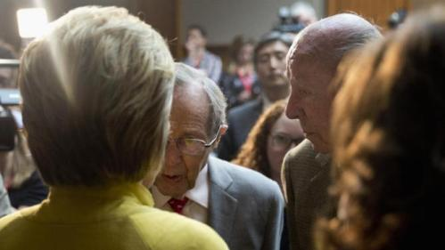 Democratic presidential candidate Hillary Clinton speaks with former Secretary of State George Shultz, right, and former Defense Secretary William Perry, center, after speaking about counterterrorism, Wednesday, March 23, 2016, at the Bechtel Conference Center at Stanford University in Stanford, Calif. (AP Photo/Carolyn Kaster)