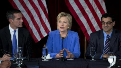 Democratic presidential candidate Hillary Clinton, joined by Los Angeles Mayor Eric Garcetti, left, and President of the Muslim Public Affairs Council Salam Al-Marayati, right, speaks during a roundtable with Muslim community leaders at the University of Southern California in Los Angeles, Thursday, March 24, 2016. (AP Photo/Carolyn Kaster)