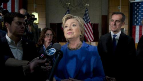 Democratic presidential candidate Hillary Clinton, joined by Los Angeles Mayor Eric Garcetti, right, pauses as she talks to media after a roundtable with Muslim community leaders at the University of Southern California in Los Angeles, Thursday, March 24, 2016. (AP Photo/Carolyn Kaster)