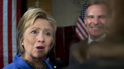 Democratic presidential candidate Hillary Clinton, joined by Los Angeles Mayor Eric Garcetti, right, greets people in the audience after a roundtable with Muslim community leaders at the University of Southern California in Los Angeles, Thursday, March 24, 2016. (AP Photo/Carolyn Kaster)