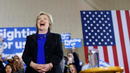 Democratic presidential candidate Hillary Clinton laughs as she is introduced during a rally at the Mary Ryan Boys and Girls Club in Milwaukee, Wis., Monday, March 28, 2016. (AP Photo/Patrick Semansky)