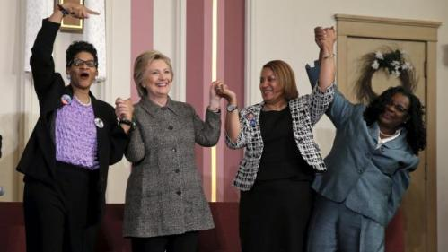 U.S. Democratic presidential candidate Hillary Clinton (2nd L) is joined by Geneva Reed-Veal (L), Annette Holt (2nd R) and U.S. Rep. Gwen Moore (D-WI) at a campaign event at Tabernacle Community Baptist Church in Milwaukee, Wisconsin, United States, March 29, 2016. REUTERS/Jim Young