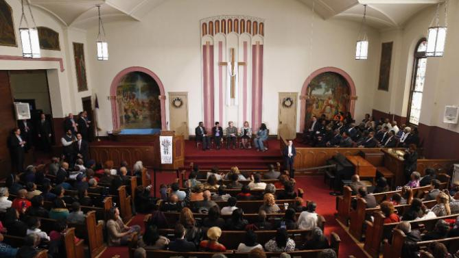 Democratic presidential candidate Hillary Clinton, center, attends a forum on gun violence at the Tabernacle Community Baptist Church in Milwaukee, Tuesday, March 29, 2016. (AP Photo/Patrick Semansky)