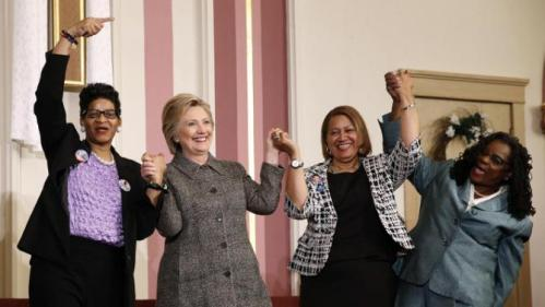 Democratic presidential candidate Hillary Clinton, stands with. from left, Geneva Reed-Veal, Annette Holt and Rep. Gwen Moore, D-Wis., after attending a forum on gun violence, Tuesday, March 29, 2016, at the Tabernacle Community Baptist Church in Milwaukee. (AP Photo/Patrick Semansky)