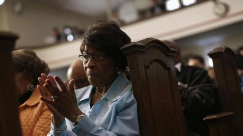 Gertrude Bass-Henderson applauds as she attends a forum on gun violence featuring Democratic presidential candidate Hillary Clinton, Tuesday, March 29, 2016, at the Tabernacle Community Baptist Church in Milwaukee. (AP Photo/Patrick Semansky)