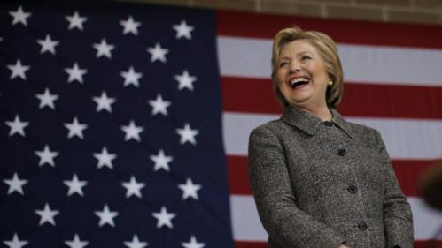 U.S. Democratic presidential candidate Hillary Clinton laughs during a campaign event in La Crosse, Wisconsin, United States, March 29, 2016. REUTERS/Jim Young