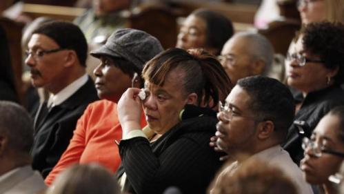 A woman wipes her eyes as she listens to a forum on gun violence featuring Democratic presidential candidate Hillary Clinton, Tuesday, March 29, 2016, at the Tabernacle Community Baptist Church in Milwaukee. (AP Photo/Patrick Semansky)