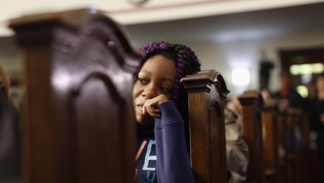 A woman listens to a forum on gun violence featuring Democratic presidential candidate Hillary Clinton, Tuesday, March 29, 2016, at the Tabernacle Community Baptist Church in Milwaukee. (AP Photo/Patrick Semansky)