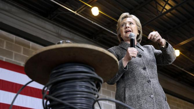 Democratic presidential candidate Hillary Clinton speaks alongside a spool of cable at Western Technical College in La Crosse, Wis., Tuesday, March 29, 2016. (AP Photo/Patrick Semansky)