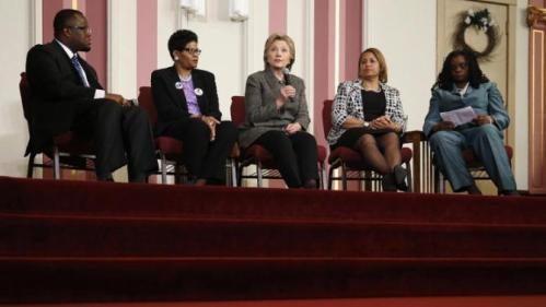 Democratic presidential candidate Hillary Clinton speaks during a forum on gun violence, Tuesday, March 29, 2016, at the Tabernacle Community Baptist Church in Milwaukee. From left are, Pastor Don Darius Butler, Geneva Reed-Veal, Annette Holt and Rep. Gwen Moore, D-Wis. (AP Photo/Patrick Semansky)