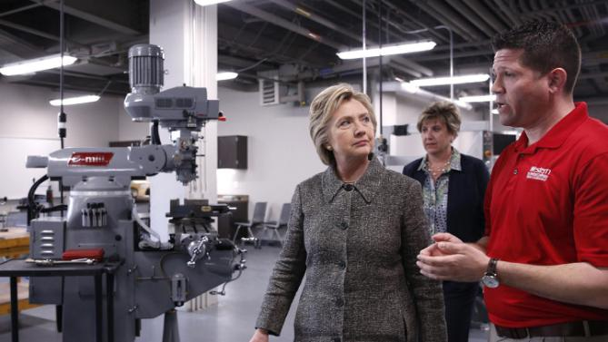 Democratic presidential candidate Hillary Clinton tours Western Technical College before holding a rally in La Crosse, Wis., Tuesday, March 29, 2016. (AP Photo/Patrick Semansky)