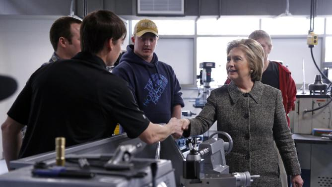 Democratic presidential candidate Hillary Clinton greets workers during a tour of Western Technical College before holding a rally in La Crosse, Wis., Tuesday, March 29, 2016. (AP Photo/Patrick Semansky)
