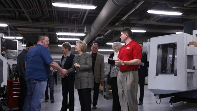 Democratic presidential candidate Hillary Clinton shakes hands with student Paul Stacey as she tours Western Technical College in La Crosse, Wis., Tuesday, March 29, 2016. (AP Photo/Patrick Semansky)