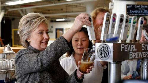 Democratic presidential candidate Hillary Clinton pours a beer during a tour of Pearl Street Brewery in La Crosse, Wis., Tuesday, March 29, 2016. (AP Photo/Patrick Semansky)