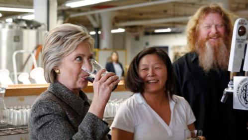 Democratic presidential candidate Hillary Clinton sips a beer during a tour of the Pearl Street Brewery in La Crosse, Wis., Tuesday, March 29, 2016. (AP Photo/Patrick Semansky)