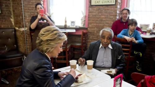 Democratic presidential candidate Hillary Clinton, right, has coffee and cake with Rep, Charles Rangel, D-N.Y. during a campaign stop at the Make My Cake bakery, Wednesday, March 30, 2016, in the Harlem neighborhood of New York. (AP Photo/Mary Altaffer)