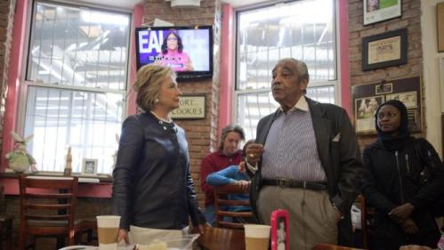 Democratic presidential candidate Hillary Clinton, left, meets Rep, Charles Rangel, background, D-N.Y. during a campaign stop at the Make My Cake bakery, Wednesday, March 30, 2016, in the Harlem neighborhood of New York. (AP Photo/Mary Altaffer)