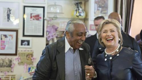 Democratic presidential candidate Hillary Clinton, right, meets Rep, Charles Rangel, background, D-N.Y. during a campaign stop at the Make My Cake bakery, Wednesday, March 30, 2016, in the Harlem neighborhood of New York. (AP Photo/Mary Altaffer)