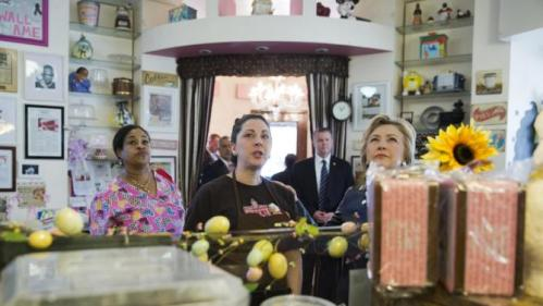 Democratic presidential candidate Hillary Clinton, right, decides what to order during a campaign stop at Make My Cake Bakery, Wednesday, March 30, 2016, in the Harlem neighborhood of New York. (AP Photo/Mary Altaffer)