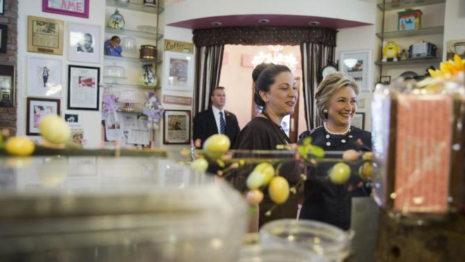Democratic presidential candidate Hillary Clinton, right, makes a campaign stop at Make My Cake Bakery, Wednesday, March 30, 2016, in the Harlem neighborhood of New York. (AP Photo/Mary Altaffer)