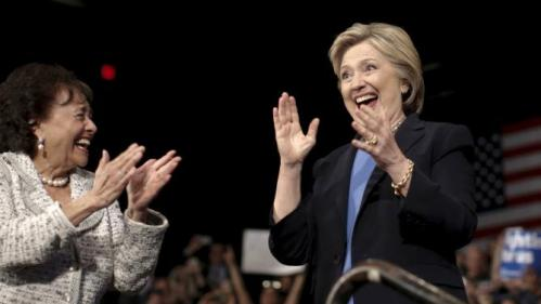 U.S. Representative Nita Lowey (L) applauds U.S. Democratic presidential candidate Hillary Clinton (R) as she takes the stage for a campaign rally at State University of New York (SUNY) at Purchase in Westchester County, New York, March 31, 2016. REUTERS/Mike Segar