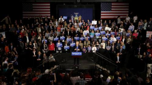 Democratic presidential candidate Hillary Clinton, center, speaks at a rally in Purchase, N.Y., Thursday, March 31, 2016. (AP Photo/Seth Wenig)