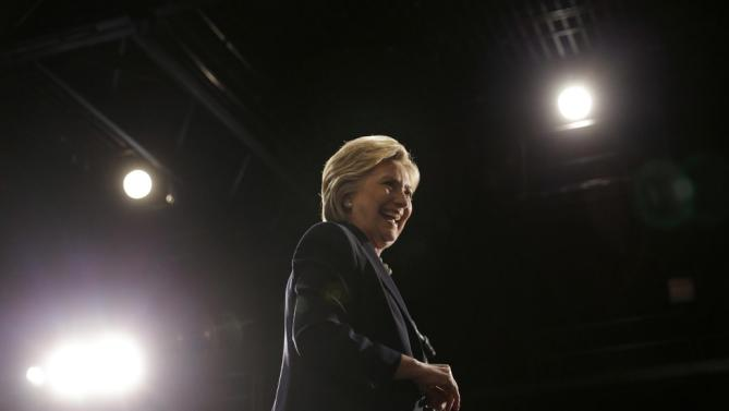 Democratic presidential candidate Hillary Clinton leaves the podium after speaking at a rally in Purchase, N.Y., Thursday, March 31, 2016. (AP Photo/Seth Wenig)
