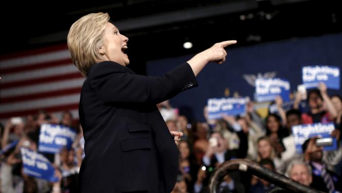 U.S. Democratic presidential candidate Hillary Clinton reacts to the audience as she takes the stage during a campaign rally at State University of New York (SUNY) at Purchase in Westchester County, New York, March 31, 2016. REUTERS/Mike Segar