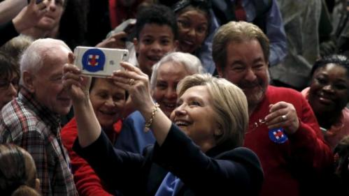 U.S. Democratic presidential candidate Hillary Clinton takes a selfie photograph with supporters after speaking at a campaign rally at State University of New York (SUNY) at Purchase in Westchester County, New York, March 31, 2016. REUTERS/Mike Segar
