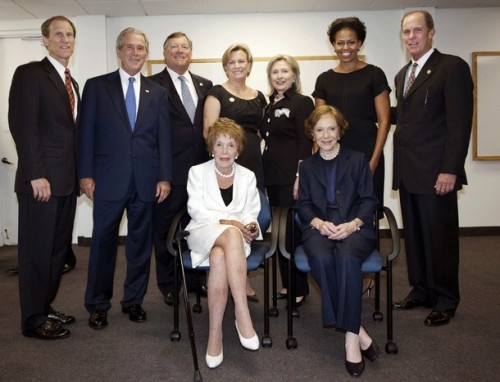 "(Top row from L to R) Mike Ford, former U.S. president George W. Bush, Jack Ford, Susan Ford Bales, former first lady and U.S. Secretary of State Hillary Rodham Clinton, U.S. first lady Michelle Obama and Steve Ford stand as former first lady Nancy Reagan (in white) and former first lady Rosalynn Carter sit as they gather for a photo before the funeral of former first lady Betty Ford at St. Margaret's Episcopal Church Tuesday in Palm Desert, California July 12, 2011. Betty Ford was remembered at a memorial service in California on Tuesday as a mother, first lady, friend and ""tireless advocate for those struggling"". Ford, wife of late President Gerald Ford who helped found a rehabilitation clinic that bears her name, died on Friday at the age of 93. REUTERS/Gerald R. Ford Library and Museum, David Hume Kennerly/Pool (UNITED STATES - Tags: POLITICS OBITUARY)"