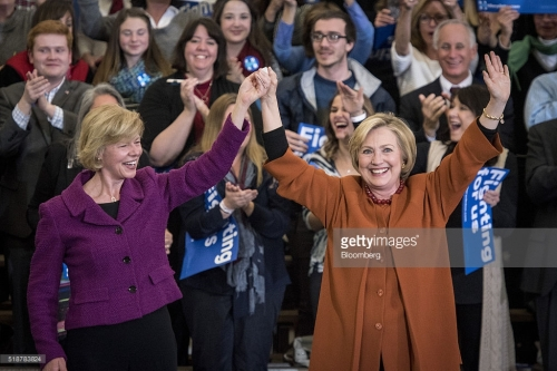Hillary Clinton, former Secretary of State and 2016 Democratic presidential candidate, right, is joined on stage by Senator Tammy Baldwin, a Democrat from Wisconsin, during a campaign event in Eau Claire, Wisconsin, U.S., on Saturday, April 2, 2016. Clinton used Donald Trump's remarks about punishing women who have abortions if the procedure were outlawed to level a double-barreled attack on the Republican front-runner as well as her Democratic rival, Bernie Sanders. Photographer: Christopher Dilts/Bloomberg *** Local Caption *** Hillary Clinton; Tammy Baldwin